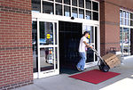 Wheeling a hand truck, this 1996 image depicted a