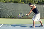 Caught in a mid-forehand swing, this young man was