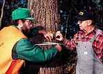 Iowa DNR forester counsels a woodland owner in nor