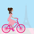 Girl cycling in paris