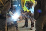 Joe Bertrand teaches welding