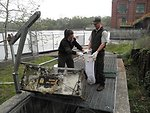 Service Employees at St. Joe River, Michigan checking Sea Lamprey Traps.