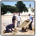 An improved reflection: AOC masons making repairs to drained Capitol Reflecting Pool.