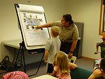 SCEP Intern Laurel Heino teaching about Sloth Bears