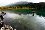 Visitor fishing in Uganik Lake