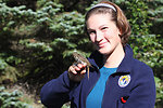 Avian volunteer Katie Studholme with a banded landbird