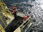 Service Employees Checking a Sea Lamprey Trap in the Menominee River, Michigan.