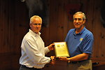 Regional Director Tom Melius presents President of Federal Premium Ammunition Ron Johnson with Plaque