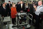 GM Uzbekistan General Director Spendel Shows a Completed Engine to Secretary Clinton and Uzbek Deputy Prime Minister Rozukulov