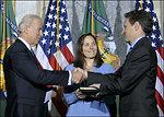 Secretary Geithner being sworn-in