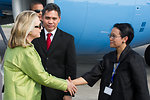 Secretary Clinton Is Greeted By Indonesian Foreign Ministry Director Marsudi