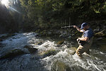 Fisheries technician uses radio antenna to track tagged bull trout