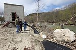 Director Dan Ashe views damage at the hatchery along the White River.