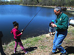 Regional Director Tom Melius Helps a Student with Fishing Bait