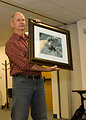 Ed Bangs Displays a Framed Image of one of his Favorite Animals: the Wolverine (gulo gulo)