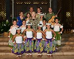 Secretary Clinton Poses with Hula Dancers