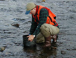 USFWS biologist collecting stream substrate data