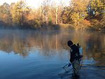 Jason Krebill, Service employee, collects sea lamprey larvae on the Au Sable River, near Oscoda MI, in late October.