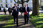 Secretary Kerry Points British Foreign Secretary Hague Toward Meeting Site in the Netherlands