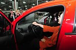 Secretary Clinton Sits Behind the Wheel of a Chevrolet Spark