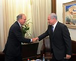 Special Envoy Mitchell Shakes Hands With Israeli Prime Minister Netanyahu