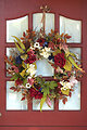 Floral wreath on a red door
