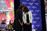 First Lady Michelle Obama With 2014 IWOC Awardee Roshika Deo