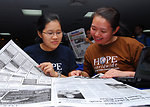 HOPE Worldwide Members Tan and Dewi Translate Indonesian Newspapers