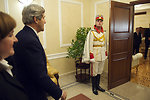 A Member of a Moldovan Honor Guard Welcomes Secretary Kerry to the Moldovan Presidential Residence