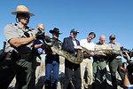 Group shot of Secretary Salazar, Senator Ben Nelson, and Dan Ashe with Python