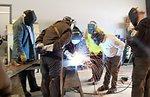 Joe Bertrand teaches welding