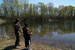 Kid Fishes with Help from Laura Bonneau, Visitor Services Manager at MN Valley NWR.