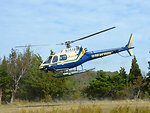 U.S. Fish and Wildlife Service helicopter takes off