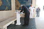 Secretary Kerry Signs the Guestbook at the Manila American Cemetery