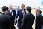 Secretary Kerry Greets Government Officials Upon Arrival in Vietnam
