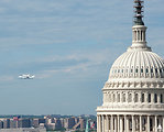 Shuttle Discovery flies by the U.S. Capitol Building