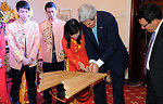 Secretary Kerry Receives Instruction on Playing a Vietnamese Bamboo Instrument