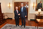 Secretary Kerry Shakes Hands With IAEA Director General Amano