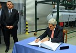 Secretary Kerry Signs the Guestbook at the Lask Polish Airbase