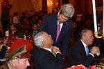 Secretary Kerry Shakes Hands With Former Secretary Powell