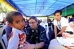 Lt. (Dr.) Stacy Dodt Examines a Young Indonesian Patient