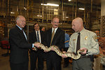 Department of the Interior employees holding a boa constrictor
