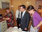 Nina, Matt Lowe, and Anna Whittington Gather Around the Table