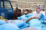 Secretary Kerry Observes the Rice-Parceling Process at the Tacloban City Welfare Distribution Center
