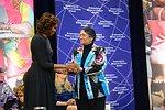 First Lady Michelle Obama Embraces 2014 IWOC Awardee Oinikhol Bobonazarova of Tajikistan
