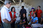 Secretary Kerry Speaks to a Tacloban City Family Awaiting Typhoon Recovery Aid