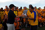 PP2010 Commander Capt. Franchetti Gives an Indonesian Soccer Team Representative a Signed Ball