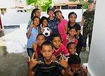 PP 2010 Commander Capt. Franchetti Poses for a Photo With Indonesian Children