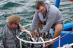 August 9, 2011 Crew technicians work away on the CTD