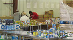 November 15, 2012 Volunteers at the Food Bank of Delaware sort through donations.